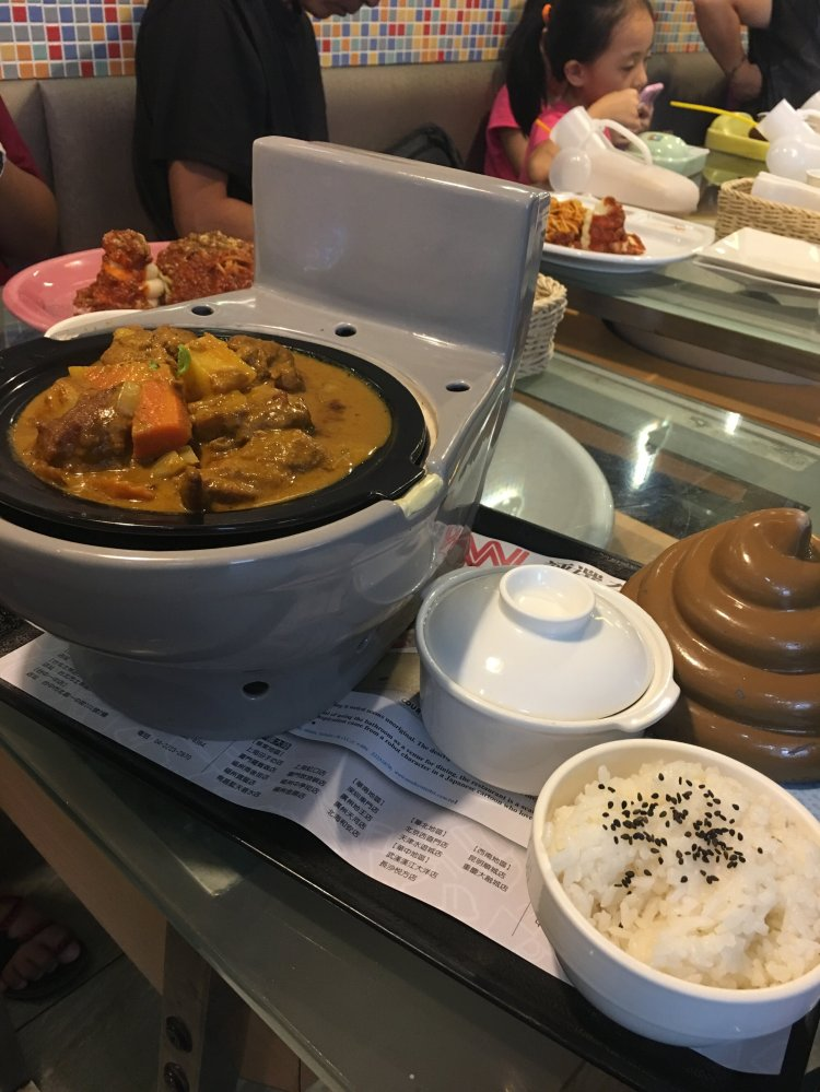 Curry and rice served in toilet dishes