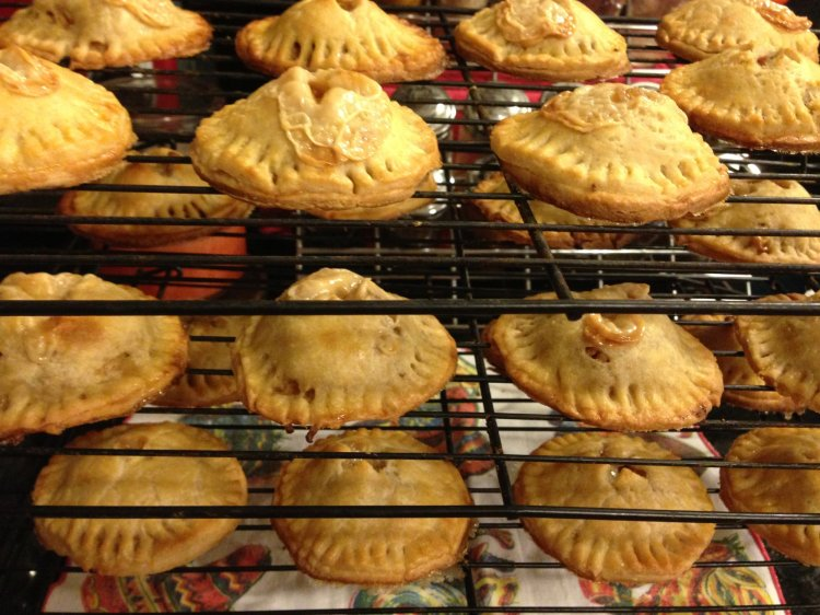 Cooling racks that contain dozens of apple hand pies