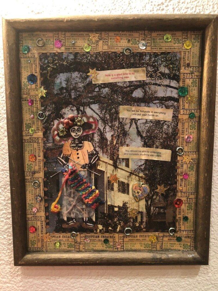 Gold framed collage artwork