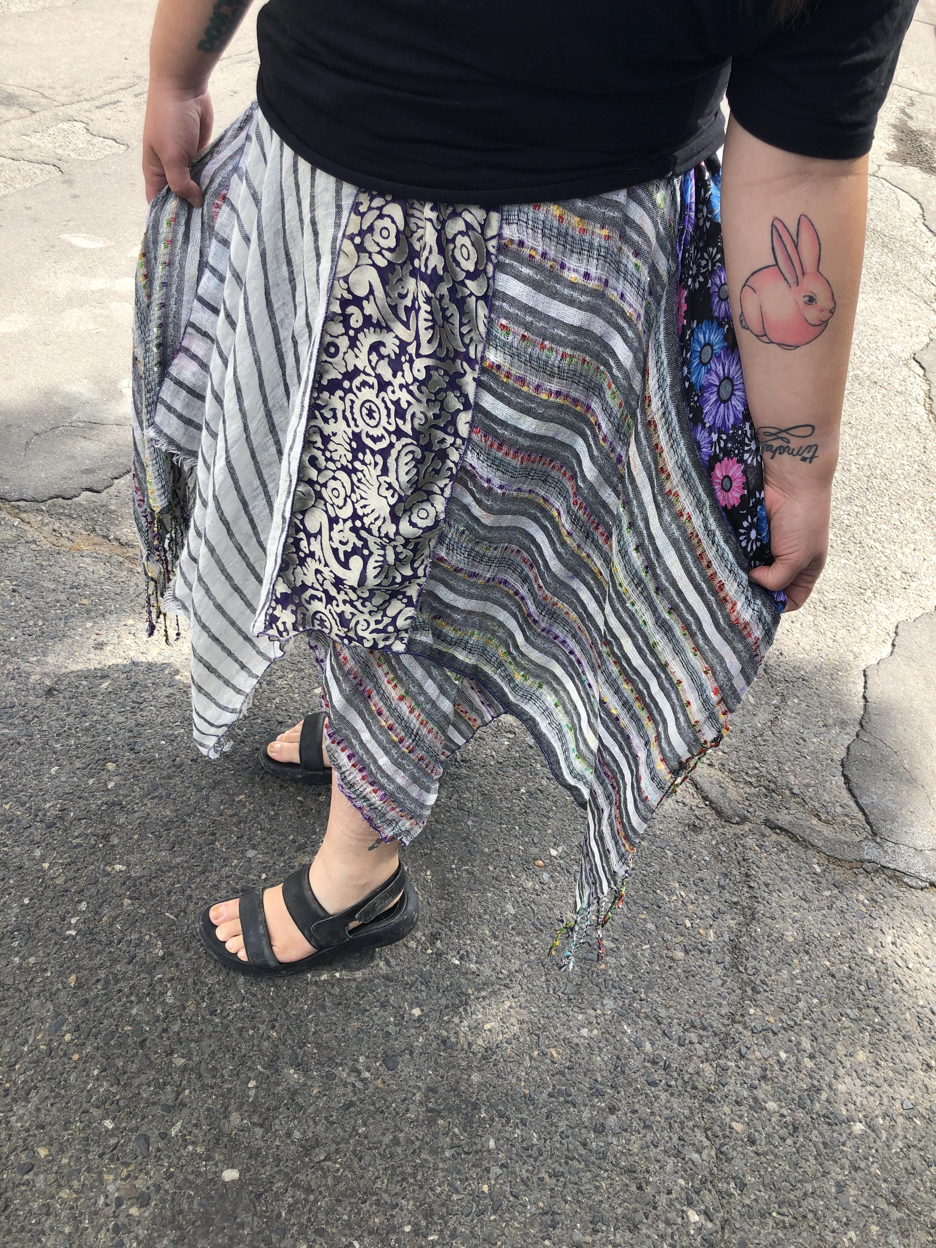 Homemade handkerchief worn by woman in black sandals